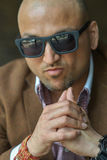 Portrait of a hansome indian businessman wearing sunglasses, serious and confident man looking at camera Stock Photography