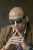 Portrait of a hansome indian businessman wearing sunglasses, serious and confident man looking at camera Royalty Free Stock Image