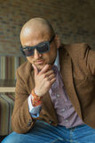 Portrait of a hansome indian businessman wearing sunglasses, serious young man thinking Royalty Free Stock Photos