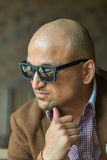 Portrait of a hansome indian businessman wearing sunglasses, serious young man thinking Stock Photos