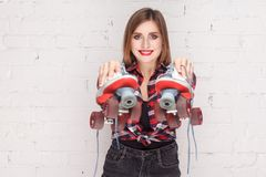 Portrait of happiness woman, pointing at quads camera. Royalty Free Stock Images