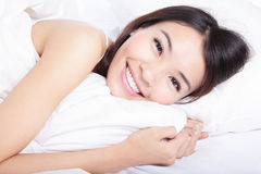 Portrait of happiness woman smile lying on bed Stock Images
