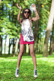 Portrait of Happy and Active African American Teenager Girl Making a Jump Royalty Free Stock Photos