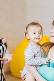 Portrait of happy adorable baby boy with mother indoors Stock Photos