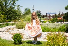 Portrait of happy adorable child girl outdoor. Cute little kid in summer day royalty free stock photos