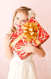 Portrait of happy adorable little girl with gift box Stock Images