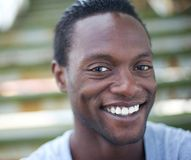 Portrait of a happy africa american man smiling outdoors royalty free stock image