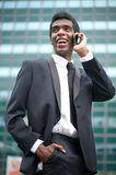 Portrait of a happy african american businessman on the phone Stock Photo