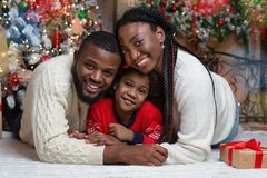 Portrait of happy african american family on Christmas Eve