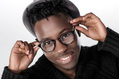 African-American man in glasses. Portrait of happy African-American man in glasses and hat Stock Images