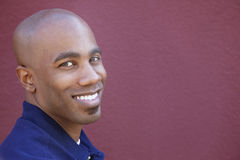 Portrait of a happy African American man over colored background Stock Photo