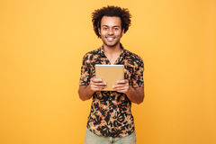 Portrait of a happy afro american guy holding pc tablet Royalty Free Stock Images