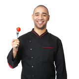 Portrait of happy Afro American professional cook with fork and Royalty Free Stock Photography