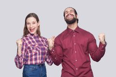 Portrait of happy amazed bearded man and woman in casual style s stock photos