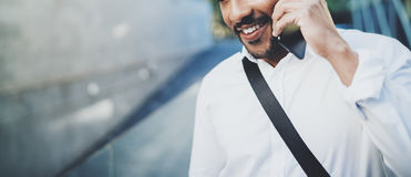Portrait of happy American African man using smartphone to call friends at sunny street.Concept of happy young people Stock Image
