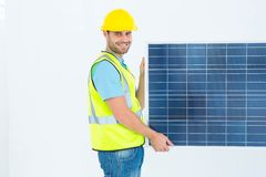 Portrait of happy architect holding solar panel Royalty Free Stock Photography