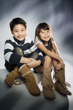 Portrait of happy asian boy and girl having fun. Portrait of happy asian boy and girlwith shadow and lighting Stock Photography