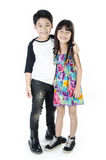 Portrait of happy asian boy and girl having fun. Isolate on white background Stock Photos
