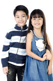 Portrait of happy asian boy and girl having fun. Isolate on white background Stock Photography