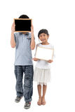 Portrait of happy asian boy and girl. Holding blank blackboard and whiteboard on white, space for your text Royalty Free Stock Image