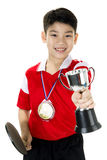Portrait of Happy asian boy play table tennis Stock Photo