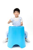 Portrait of happy asian boy sitting and acting drive a car Royalty Free Stock Photos