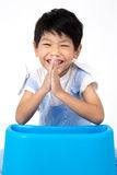 Portrait of happy asian boy sitting and laugh Stock Photography