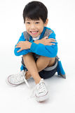 Portrait of happy asian boy sitting and laugh Royalty Free Stock Images