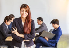 Portrait of happy asian businesswoman, people group in backgroun Stock Image