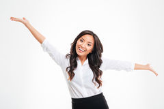 Portrait of a happy asian busineswoman with raised hands up Stock Image