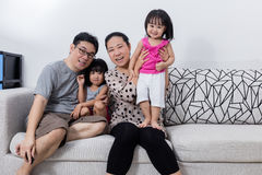 Portrait of Happy Asian Chinese Family Sitting on Couch Royalty Free Stock Photography