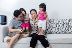 Portrait of Happy Asian Chinese Family Sitting on Couch Stock Image