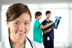 Portrait of a happy Asian Doctor Stock Photos