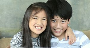 Portrait of happy asian family Sister and brother acting on face an looking camera . Portrait of happy asian family Sister and brother are acting on face an stock video