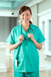 Portrait of a happy Asian Female Doctor. Stock Photo