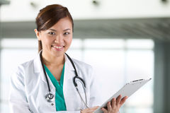 Portrait of a happy Asian Female Doctor. Stock Images