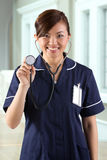Portrait of a happy Asian Female Nurse Royalty Free Stock Photography
