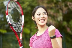 Portrait of happy asian female tennis player stock images