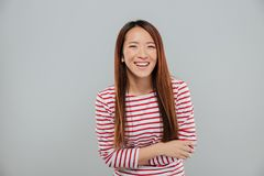 Portrait of a happy asian girl laughing while standing Royalty Free Stock Images