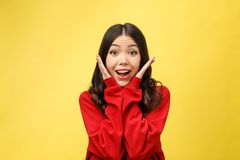 Portrait Happy Asian girl is surprised she is excited.Yellow background studio.  royalty free stock photos