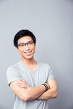 Portrait of a happy asian man with arms folded Stock Photography