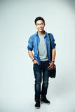 Portrait of a happy asian man with bag Stock Photography