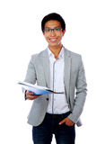 Portrait of a happy asian man with folder Stock Image
