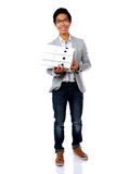 Portrait of a happy asian man with folders Stock Images
