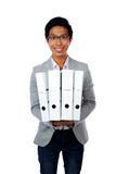 Portrait of a happy asian man with folders Stock Photo