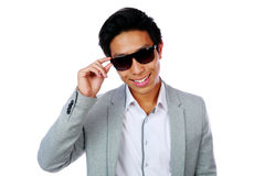 Portrait of a happy asian man in sunglasses Stock Images