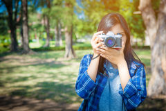 Portrait of happy Asian woman taking photos Stock Photo