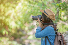 Portrait of happy Asian woman taking photos Royalty Free Stock Images