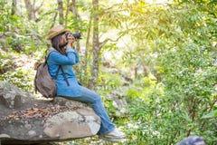 Portrait of happy Asian woman taking photos Royalty Free Stock Photo
