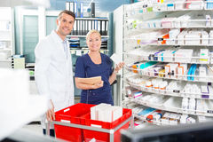 Portrait Of Happy Assistant And Pharmacist Royalty Free Stock Photos